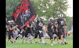 The Greene County Rams won their second straight game Sept. 10, defeating Kuemper Catholic, 13-3 in a tense battle at home. Mason Stream (62) is pictured carrying the team flag prior to kick-off.  BRANDON HURLEY | JEFFERSON HERALD