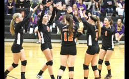 The Paton-Churdan varsity volleyball team celebrates after an ace serve by Sydney Koch (left).