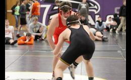Greene County senior Bryce Hoyle (back) captured a Class 2A sectional title Saturday, Feb. 2 in Ida Grove, upsetting the number one seed in the 195 pound bracket. Five Rams advanced to Saturday's district tournament in Harlan.  PHOTO COURTESY OF ABBY DAVIS