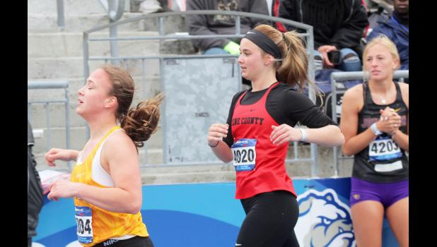 Greene County's Melanie Doran slows herself following the opening leg of the 4-by-100-meter relay prelims at the 2019 Drake Relays Saturday, April 27 in Des Moines. The Rams finished 89th with a time of 53.48. BRANDON HURLEY | JEFFERSON HERALD
