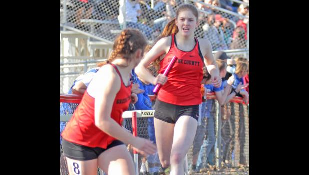 Greene County's Natalie Heupel (right) hands the baton off to Olivia Shannon during the sprint medley relay at the annual Ram Early Bird Relays Monday in Jefferson. The Rams finished third with a time of 2:00.61.  BRANDON HURLEY | JEFFERSON HERALD