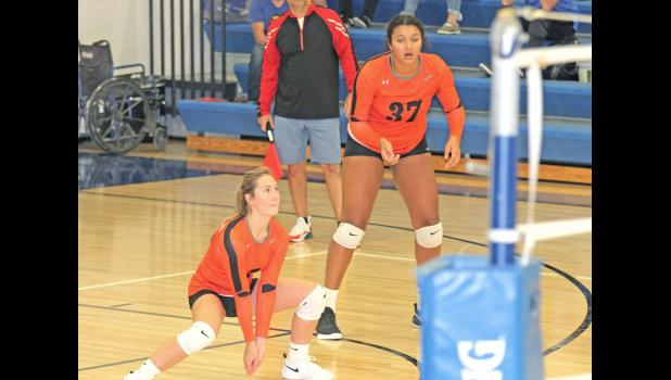 Paton-Churdan's Carmyn Paup (left) and Danielle Hoyle (right) ready theirselves for a return during the Rockets' 2-0 win over Ogden Oct. 5.  BRANDON HURLEY | JEFFERSON HERALD