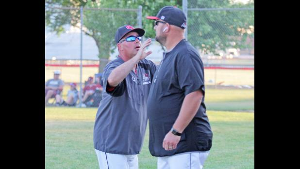 Greene County's Kevin Paulsen (left) has been a local baseball coach for nearly 20 years. He now has extra incentive in the dugout, his son, Matt, is the varsity head coach.  BRANDON HURLEY | JEFFERSON HERALD