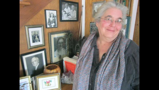 Liz Garst, standing next to family photos at her home near Coon Rapids, will talk at 2:30 p.m. Jan. 12 at the Greene County Historical Society museum in Jefferson about the time Soviet Premier Nikita Khrushchev visited her grandfather's farm in the area.
