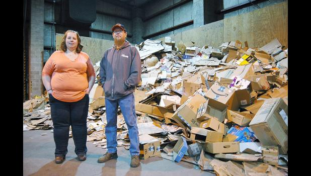 Just a normal day at Genesis Development: Ashley Coil (left) and Brandon Murphy, who oversee the recycling center at Genesis, want people to be more mindful of what they're leaving inside cardboard boxes. Increasingly, Genesis is getting stuck with plastic packing materials that can't be recycled. ANDREW McGINN | JEFFERSON HERALD PHOTOS