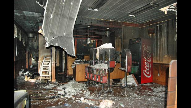 Debris covers the floor of Pizza Ranch in Jefferson the morning of Jan. 27, 2016, following an overnight fire ruled to be arson. HERALD FILE PHOTO