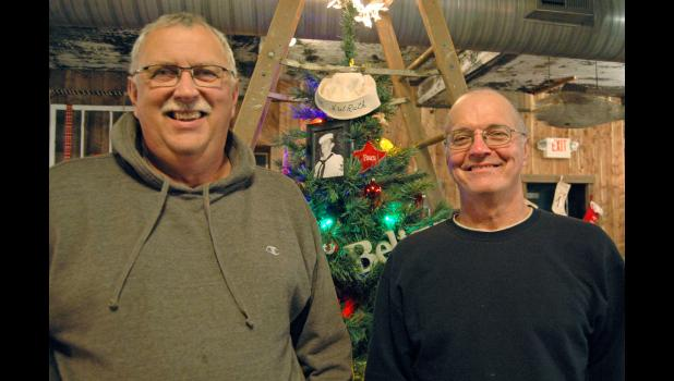 Sons of a picker: Brothers Randy (left) and Greg Ruth inherited the picking gene from dad Harold, who served in Korea aboard the appropriately named USS Pickaway. The sailor's cap worn by the late Harold Ruth topped a Christmas tree this past holiday season at the family's antiques store/events venue, Pickaway. ANDREW McGINN | JEFFERSON HERALD
