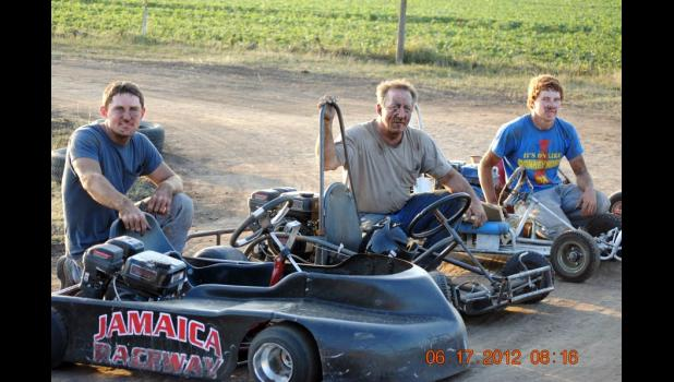 Go-karting with cousin Justin Thompson (left) and dad Scott Kiner (center)