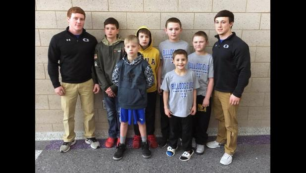 Kyler Kiner (left) and Shawn Heaning, his cousin and best friend, coached the Ogden Elite Wrestling Club.