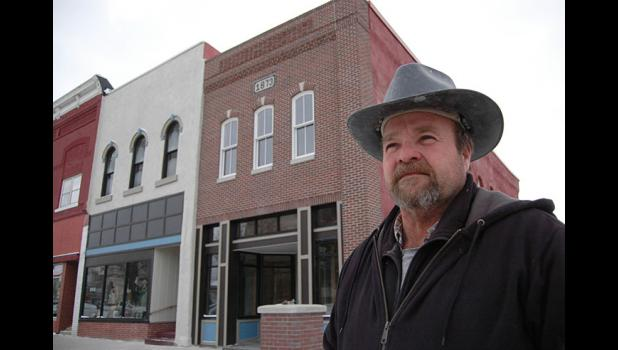 "Rippey mason Mark Devilbiss made the best of a nightmare situation after the stuccoed front of Muir Embroidery (the building at far right) gave way during a recent downtown revitalization project. Devilbiss rebuilt the facade from scratch. ""I hope they can say, 'He really likes what he's doing, because it shows in his work,' "" Devilbiss says. ANDREW McGINN 