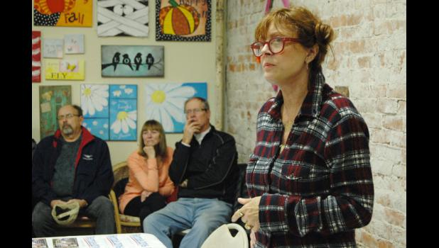 """Oscar-winning actress and progressive activist Susan Sarandon listens to a question Wednesday at Homestead Coffee and Bakery during a visit to Jefferson in support of Democratic presidential candidate Bernie Sanders. """"I'm so thrilled and terrified about this election,"""" she said. ANDREW McGINN   JEFFERSON HERALD"""