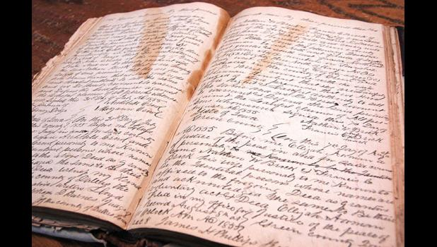 Digitization of records would cut down on the wear and tear of original documents. The pages containing the county's earliest records are increasingly brittle.