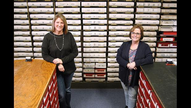 Deputy Recorder Deb McDonald (left) and Recorder Marcia Tasler are charged with safeguarding the recorded land history of Greene County. They hope to make those records available online as a way of preserving the original documents. ANDREW McGINN | JEFFERSON HERALD