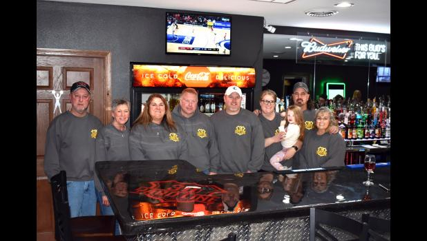 Four local couples recently banded together to open the 30 Yard Line, a bar and restaurant on Highway 30 in Grand Junction. From left: Jeff and Regina Thorpe, Jeni and Bob Ross, Andy and Mandy Krieger, and Tony and Traci Beger. CONTRIBUTED PHOTO