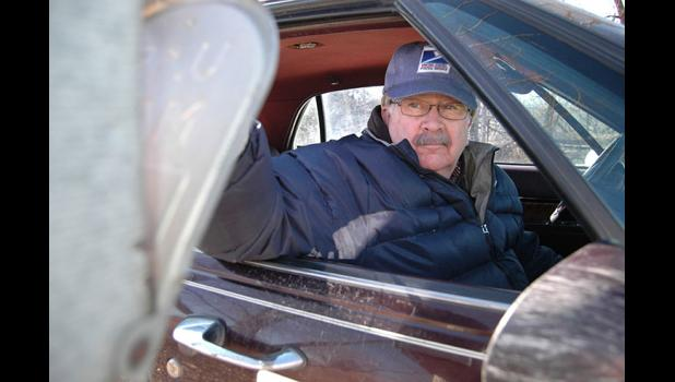 """I'd like to think that I provided a service that went above and beyond,"" says retiring rural mail carrier Mike Piepel, closing the door of a mailbox on Grimmell Road for perhaps the last time. ""Hopefully people got their money's worth."" ANDREW McGINN 
