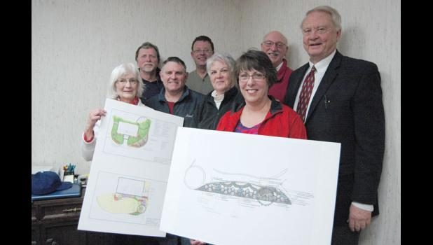 Members of the Thomas Jefferson Gardens of Greene County board hold up plans Tuesday for the site prepared by Iowa State University. Planting will likely begin in April at the site, located at Lincoln Way and Chestnut Street. Pictured are (from left) Jeane Burk, Roger Aegerter, John Turpin, Andy Krieger, Mary Weaver, Jean Van Gilder, Don Orris and Tom Polking.