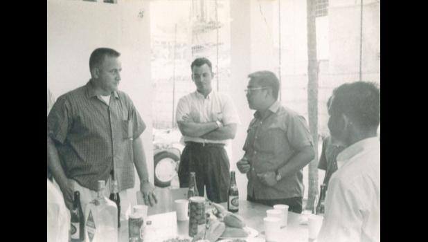 Kendall, center, in civilian clothes with the CIA in Vietnam circa 1964/1965.