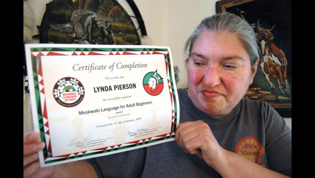 """Lynda Pierson, of Jefferson, holds up the certificate she received recently for completing the first class in a Meskwaki language course. """"I want to see it all the way through,"""" says Pierson, who grew up in Jefferson, removed from Meskwaki-speaking relatives in the Sac and Fox Tribe of the Mississippi in Iowa. The tribe's language is classified as """"critically endangered"""" by the United Nations. ANDREW McGINN 