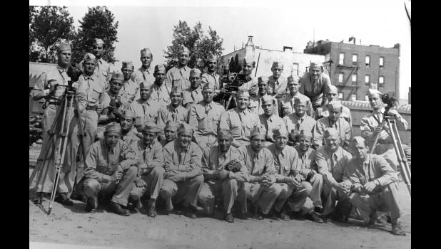 Despite a degree in forestry from Iowa State, Dana native Verle Johnson (standing second from left in the back row) spent most of his life writing and directing training and educational films for the Army after serving in World War II with Oscar winner George Stevens. He later ventured to Vietnam multiple times to make films for the Army Pictorial Center.