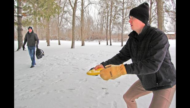 A demonstration at 10-below: Daniel Rohner takes aim at a disc golf target at Daubendiek Park. Local disc golf enthusiasts like Rohner hope to see an 18-hole disc golf course built there by summer. Build an 18-hole disc golf course and they will come, they say, which could provide an economic boost to Jefferson. ANDREW McGINN | JEFFERSON HERALD