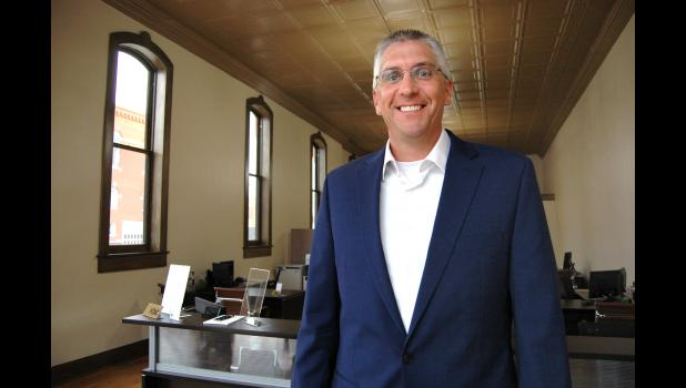 Scott Weber is leading Heartland Bank's expansion into Jefferson. The bank's southernmost branch opened this week in a historic building that the city of Jefferson bought for $100 in 2016. Windows that once were bricked in are now open, and the original tin ceiling has been exposed. ANDREW McGINN | JEFFERSON HERALD