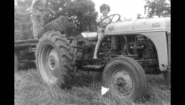 A Churdan resident since 2007, Marti Thompson is pictured at 6 on the farm in Illinois. She later argued her way into FFA four years before the organization allowed girls to join.