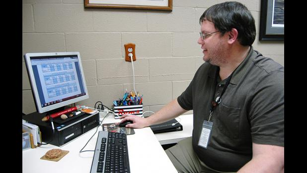 High school special needs counselor Kyle Kinne reviews data in his office from the 2016 Iowa Youth Survey showing that as many as 19 percent of local 11th graders seriously contemplated suicide in the past 12 months. Local students will be administered the survey again this fall. ANDREW McGINN | JEFFERSON HERALD