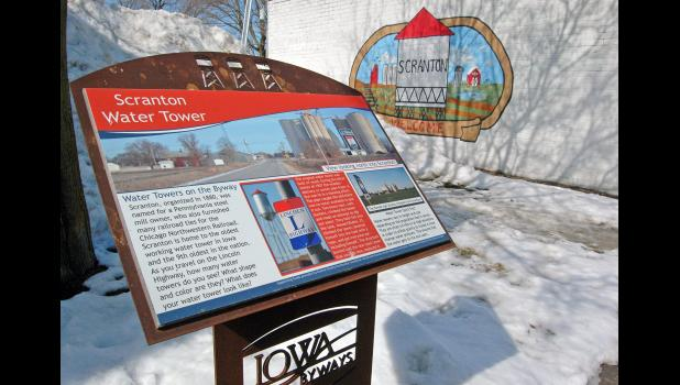 Many landmarks along the Lincoln Highway are being marked with interpretative panels for curious travelers, like this one below Iowa's oldest-working water tower in Scranton.