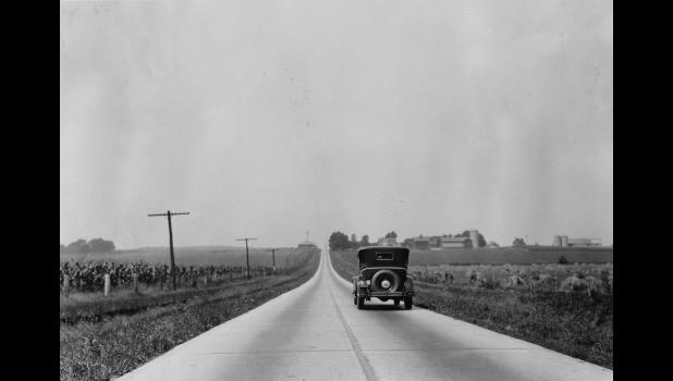 A car makes its way down the Lincoln Highway in Greene County, 1926. Until 1924, the only paved rural sections of the highway in Iowa were in Greene and Linn counties.