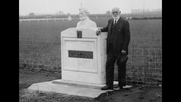 Civil War vet J.E. Moss poses in 1926 next to his memorial Lincoln monument near Scranton. The Moss Markers continue to greet travelers on the Lincoln Highway in Greene County. HERALD FILE PHOTO