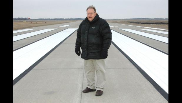 """Jim Forbes, chairman of the Jefferson Airport Commission, is pictured in December 2013 on the runway of the Jefferson Municipal Airport that will be extended in the coming years. """"It's going to be good for the community,"""" he said then, """"whether they believe it or not."""""""