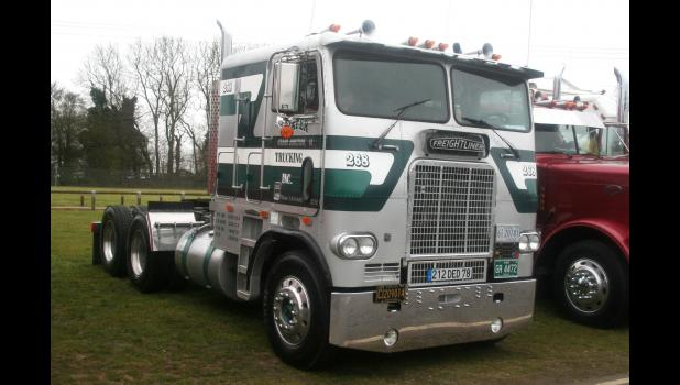 "Six days on the road: Bill Kafer's beloved Freightliner ended up across the Atlantic, where it was photographed at a truck show in England in 2016. ""It didn't look that good when we sent it there,"" wife Diane Kafer says. The words ""Kafer Trucking Inc."" and ""Grand Junction, IA"" are still on the door, identifying the truck as a big, silver slice of Americana. PHOTO BY ROBERT MATTHEWS"