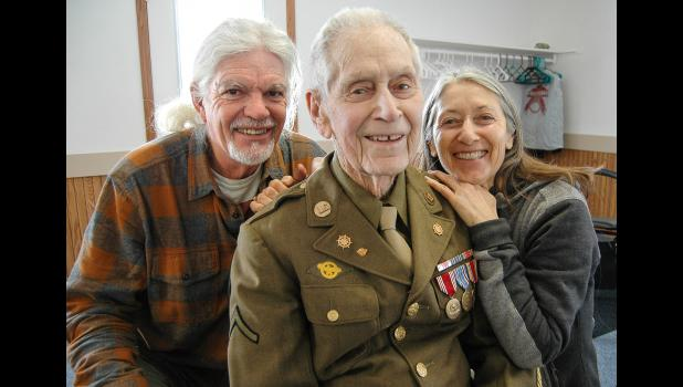 Clare Hunter (center), pictured with daughter Joanna and her partner, Billy Sammons. ANDREW McGINN | JEFFERSON HERALD