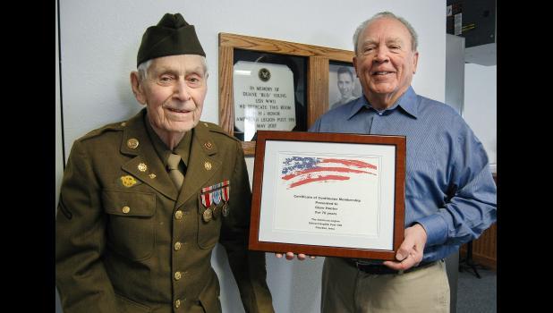 World War II veteran Clare Hunter (left) receives a certificate marking his 70th year as a member of American Legion Post 198 in Churdan from Adjutant John Lonergan. ANDREW McGINN | JEFFERSON HERALD