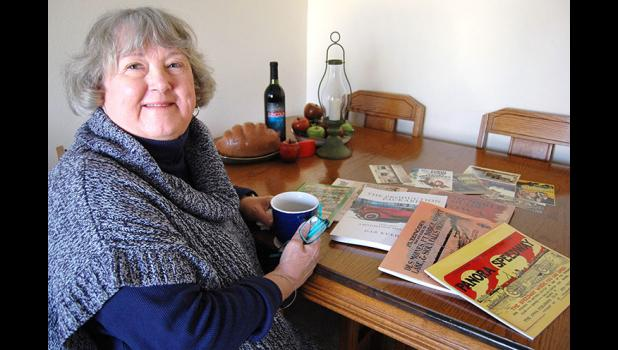 Janice Harbaugh has given a new lease on life to a number of unlikely publications, and even postcards, from early Iowa road maps to a local seed company's 1921 catalog. She's found customers from here to England. ANDREW McGINN | JEFFERSON HERALD