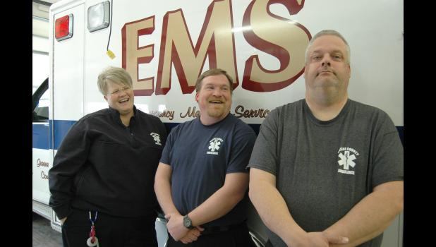 Madsen and EMT Mike Heinz (center) crack up last week at the ability of EMT Mark Renslow to not smile.