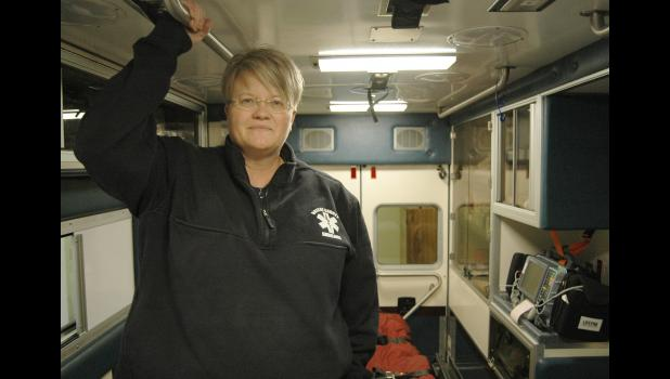 """You go home and hug your kids a lot,"" says Michele Madsen, a mother of four. A paramedic and a Greene County native, Madsen is the first director of the county's new ambulance service, which launched March 1. ANDREW McGINN 