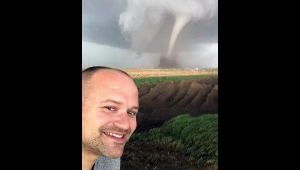 """This is not the kid I grew up with,"" Ellen Ritter says of her younger brother, Evan Bunkers. The Jefferson native, who was once terrified of severe weather, has a budding second job as a TV meteorologist and chases storms when he's not working as a flight attendant for United Airlines. He caught up to this tornado two years ago in southwest Nebraska."