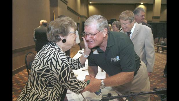 Then-Greene County supervisor Guy Richardson (right) shakes hands with Delores Mertz from the Iowa Racing and Gaming Commission following its 3-2 vote in 2014 to grant Wild Rose Entertainment and Grow Greene County a license to build a $40 million casino in Jefferson. Mertz voted in favor of giving the license for the casino. HERALD FILE PHOTOS