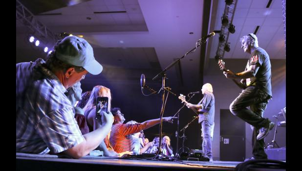 """A fan snaps a photo of Little River Band during the band's 2017 concert at Wild Rose Casino in Jefferson. The classic soft-rock group, originally from Australia, sold more than 30 million albums thanks to such late '70s hits as """"Reminiscing"""" and """"Lonesome Loser."""""""