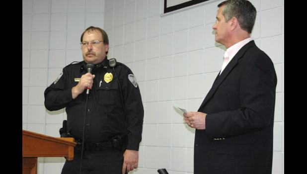 Jefferson Police Chief Dave Morlan (left) thanks the Greene County Community Foundation Monday for a $2,000 grant for an in-car computer as Tim Heisterkamp, foundation president, looks on.