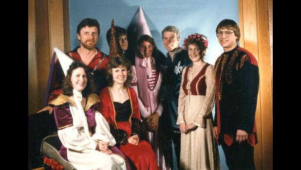 "Royal chaperones: High school teacher Teresa Green (center) pictured at prom in 1986, the year the theme was ""Camelot."" With her are assorted chaperones and junior class sponsors, from left, Clara Boyles, Roger Aegerter, Ginny Destival, Ken Feldmann, Randy Reuter, Jan Rosdail and Dave Destival. Students have graduated, friends have retired and school districts have consolidated, but Green is still in charge of organizing prom in Jefferson. ""Next thing you know,"" she says, ""you're old."""