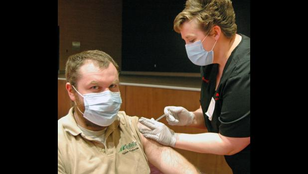 Hy-Vee pharmacist Heather Acton (right) administers a COVID-19 vaccine to Ben Pickering, of Jefferson, on March 31 at Wild Rose Casino. ANDREW McGINN | JEFFERSON HERALD