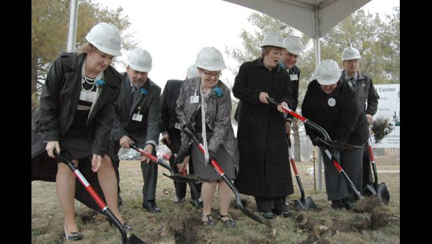 A group of Greene County Medical Center personnel digs in and throws dirt April 3 at the groundbreaking ceremony for the center's $22.5 million expansion and renovation.