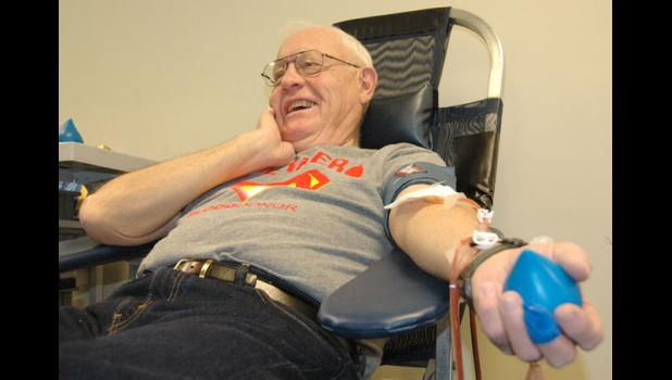 Vern Foje laughs as he gives blood recently at the Greene County Community Center. The longtime Jefferson resident has so far donated more than 44 gallons of blood.
