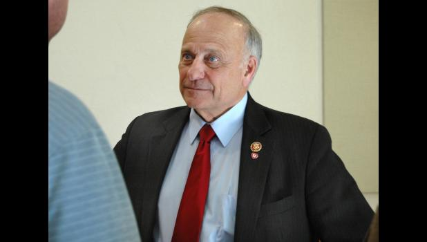 """Congressman Steve King listens to another question last Thursday following a town hall meeting at the Jefferson Community Golf Course. After years of avoiding the town hall format, King plans to hold town halls this year in all 39 of his counties. """"It's good for me to hear from you,"""" King said. ANDREW McGINN 