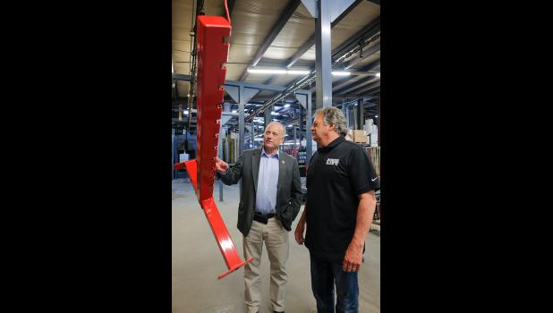 Congressman Steve King (left) looks at a component of a weightlifting rack during a tour of Power Lift with Jeff Conner, president of the Jefferson company. King said he has traveled past the company dozens of times but Tuesday was the first opportunity to tour the family-owned operation. JEFF STORJOHANN | JEFFERSON HERALD