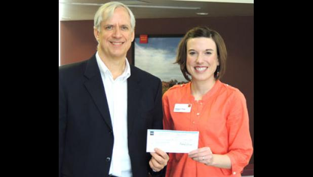 Omega J. Sang (right), store manager of the Wells Fargo Bank in Jefferson, recently presented Alan Robinson, program director of Jefferson Matters: Main Street, with a third check for $1,000. The bank made a three-year pledge to Main Street.