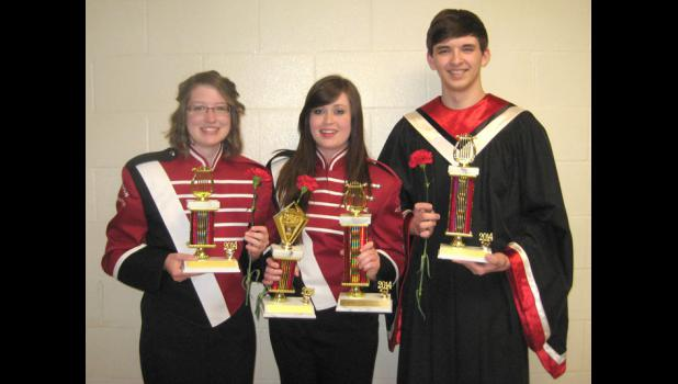 Greene County High School honored its top musicians and vocalists Tuesday night at the senior awards concert. From left: Beth Teusch received the Greene County Band Director's Award; Jasmine Mobley won the Jazz Band Award and the Lions Club Arion Award for band; Logan Hoyt received the Lions Club Arion Award for vocal music.