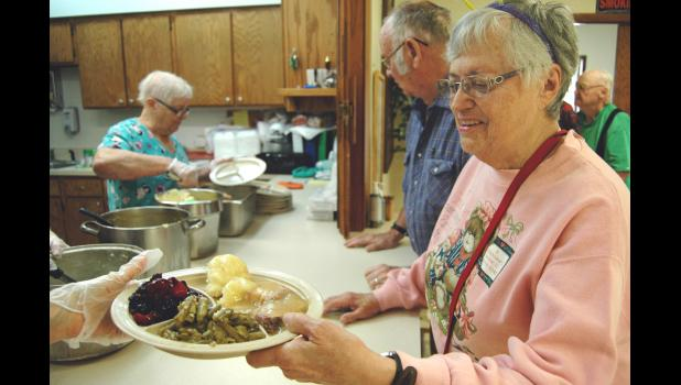 Joyce Frazier takes a Congregate Meal last week at the Greenewood Center. The organization that serves the meals, Elderserve, is celebrating its 40th anniversary this month. ANDREW McGINN | JEFFERSON HERALD
